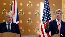 Britain's Foreign Secretary Boris Johnson (L) listens as U.S. Secretary of State John Kerry speaks during a press conference at the Foreign Office in London, July 19, 2016.