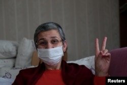 FILE - Pro-Kurdish Peoples' Democratic Party (HDP) lawmaker Leyla Guven, who is on hunger strike for nearly three months, is pictured at her home after being released from prison, in Diyarbakir, Turkey, Jan. 25, 2019.