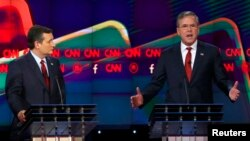 FILE - U.S. Senator Ted Cruz of Texas, left, and former Florida Governor Jeb Bush spar during the Republican presidential debate in Las Vegas, Nevada, Dec. 15, 2015.