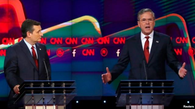 FILE - U.S. Senator Ted Cruz of Texas, left, and former Florida Governor Jeb Bush spar during the Republican presidential debate in Las Vegas, Nevada, Dec. 15, 2015.