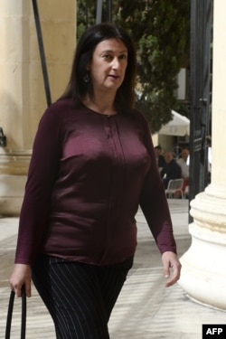 FILE - Journalist and blogger Daphne Caruana Galizia is pictured April 27, 2017, arriving at the Law Court in Malta.