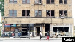 A burned down liquor store is seen after disturbances following the police shooting of a man in Milwaukee, Wisconsin, U.S., August 15, 2016.