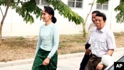Myanmar's new de facto leader Aung San Suu Kyi, left, arrives at a hospital for her eye operation in Naypyitaw, April 9, 2016.