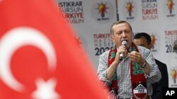 Turkey's Prime Minister Tayyip Erdogan addresses his Justice and Development Party (AKP) supporters during an election rally in Diyarbakir, in Kurdish-dominated southeastern Turkey, June 1, 2011
