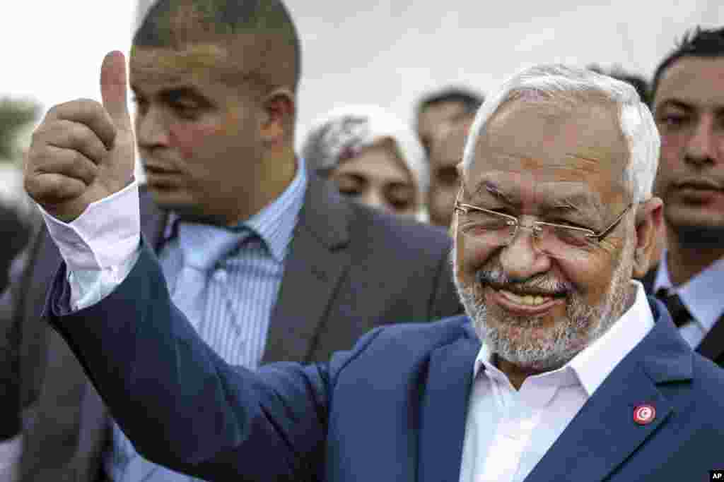 Rachid Ghannouchi, leader of the Tunisian moderate Islamist Ennahda Party, gestures before casting his vote at a polling station in Ben Arous, Tunisia, Oct. 26, 2014.