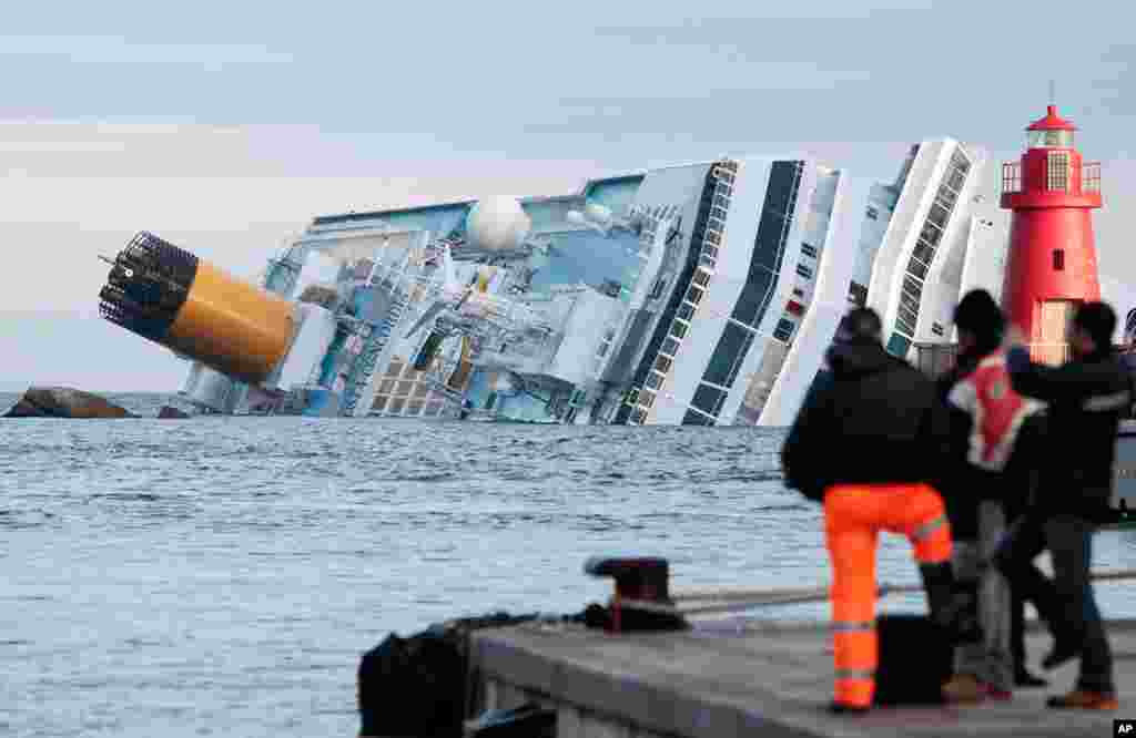 January 18: The cruise ship Costa Concordia lays on its side off the tiny Tuscan island of Giglio, Italy, after striking a rock.  At least 30 people were killed and the ship's captain was charged with manslaughter and abandoning the ship.