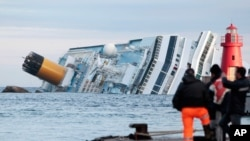 January 18, 2012: The cruise ship Costa Concordia lays on its side off the tiny Tuscan island of Giglio, Italy.