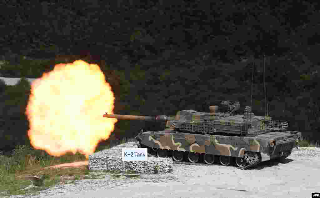 A South Korean K2 tank fires during a live fire demonstration for a media preview of the Defense Expo Korea 2018 at Seungjin Fire Training Field in Pocheon, 65 kms northeast of Seoul.