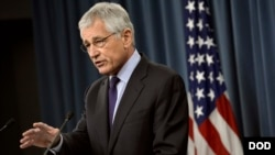 Secretary of Defense Chuck Hagel answers questions from the media during a press conference held in the Pentagon Press Briefing Room, March 31, 2014.