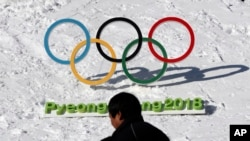 VOA Game Room - Russia's Olympic ban, Tiger Woods swings back, playoffs abound and a gym doctor is sentenced.