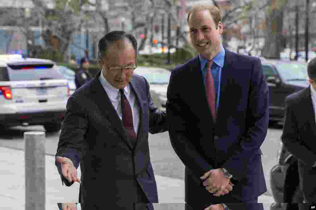 Prince William is greeted by World Bank President Jim Yong Kim before speaking on illegal transportation of wildlife parts across borders during an International Corruption Hunters Alliance event, at the World Bank in Washington, DC, Dec. 8, 2014.