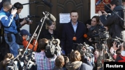 Russian opposition leader and anti-corruption blogger Alexei Navalny speaks to the media after a court hearing in Kirov, April 24, 2013.