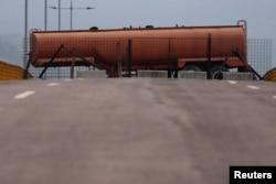 Fuel tank blocks the vehicular passage on Tienditas cross-border bridge between Colombia and Venezuela, in Cucuta, Colombia, Feb. 6, 2019.