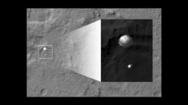 An image from a satellite obiting Mars of Curiosity's landing parachute