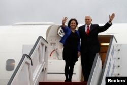 FILE - U.S. Vice President Mike Pence and his wife, Karen, wave as they prepare to depart Ben Gurion International Airport, near Tel Aviv, Israel, Jan. 23, 2018. The Pences leave Monday for a trip to Northeast Asia, including a stop at the Pyeongchang Gam