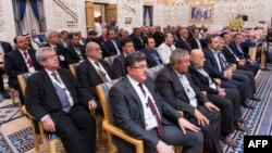A picture provided by the Saudi Press Agency shows members of the Syrian opposition during their meeting in Riyadh, Dec. 10, 2015.