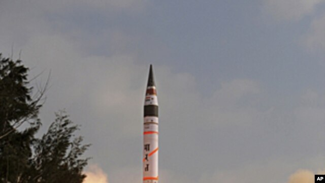 India's Agni-V missile lifts off from the launch pad at Wheeler Island off India's east coast, April 19, 2012.