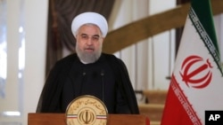 In this photo released by his office, Iranian President Hassan Rouhani addresses his nation in a televised speech, in Tehran, Oct. 13, 2017. Rouhani spoke after U.S. President Donald Trump angrily accused Iran of violating the spirit of the 2015 nuclear accord and demanded Congress toughen the law governing U.S. participation.