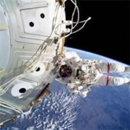 Jeffrey Williams performs a spacewalk outside the station during the STS-101 shuttle mission in May of 2000.