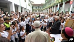 "FILE - Pope Francis pays a visit to ""Hogar San José"" children's home in Medellin, Colombia, Saturday, Sept. 9, 2017."