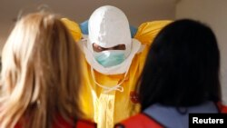 A health care worker receives training from Centers for Disease Control and Prevention (CDC) instructors in preparation for the response to the current Ebola outbreak.