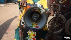 Ibrahim Sacko, a traveling storyteller, tours around Kayes on his motorbike to spread awareness on Ebola. His most important message is for people to wash their hands, Kayes, Mali, Nov. 6, 2014. (Katarina Höije)