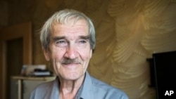 "FILE - Former Soviet missile defense forces officer Stanislav Petrov poses for a photo at his home in Fryazino, Moscow region, Russia, Aug. 27, 2015. Petrov, a former Soviet military officer known in the West as ""The man who saved the world'' for his role in averting a nuclear war over a false missile alarm, died in May at age 77."