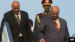 Sudan President Omar al-Bashir, right, arrives in Kigali, Rwanda, July 16, 2016, to attend an African Union summit. He defied an international warrant of arrest after public assurances from Rwandan leaders that he would not be arrested.