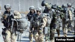 미한 양국 군이 지난달 연합부대를 편성해 북한의 핵·미사일 등 대량살상무기(WMD) 시설을 탐색하고 파괴하는 훈련을 최대규모로 진행한 것으로 확인됐다. 사진은 지난달 경기도 포천 영평사격장(로드리게스 훈련장)에서 열린 '태스크포스 아이언 레인저스'(Task Force Iron Rangers)라는 명칭의 연합부대가 북한 핵·미사일 시설 제거 훈련하는 모습.