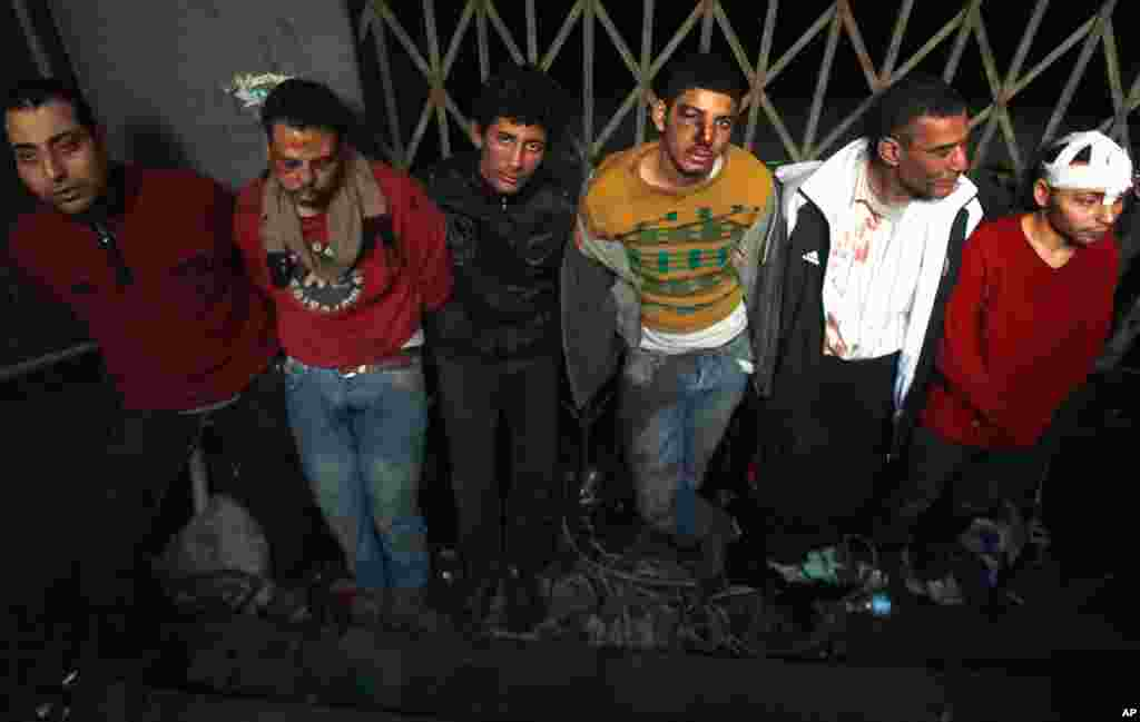 Pro-Mubarak supporters are detained by anti-government protesters after being rounded up during clashes in Cairo's Tahrir Square, February 3, 2011. (Reuters)