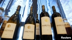 FILE - Wine bottles of Domaine de Bargylus are displayed in Beirut, Lebanon, Sept. 3, 2014.