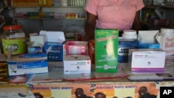 Malaria drugs are seen on display in a privately-owned pharmacy.