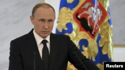 FILE - Russian President Vladimir Putin addresses the Federal Assembly at the Kremlin in Moscow.