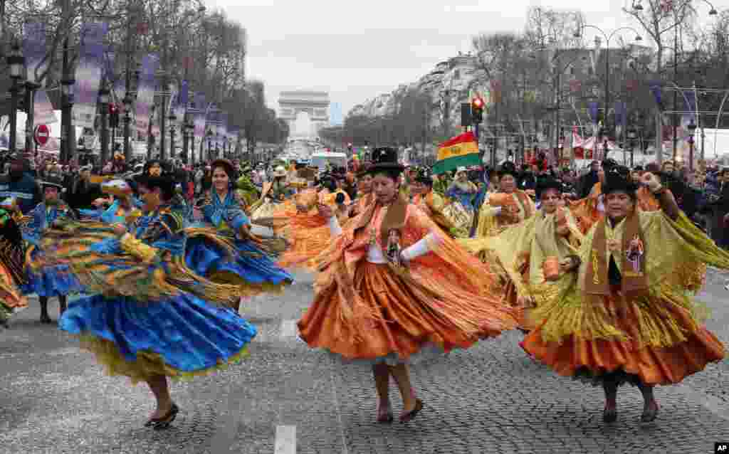 Bolivian dancers perform on the Champs Elysees to celebrate the new year, Paris, France, Jan. 1, 2014,