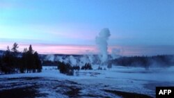 The Upper Geyser Basin at sunset in Yellowstone National Park, which extends across three western states: Wyoming, Montana and Idaho. Yellowstone was established on March 1, 1872.