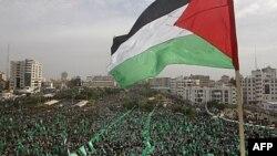 دسامبر 2011، راهپیمایی هواداران حماس در بیست و چهارمین سالروز تاسیس این گروه در نوار غزه