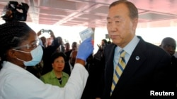 U.N. Secretary General Ban Ki-moon has his temperature checked upon arrival at the Roberts International airport in Liberia's capital Monrovia, Dec. 19, 2014.