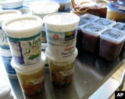 A variety of containers, some of them recycled, are used during Soup Swap night.