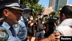 FILE - Police clash with protesters on Australia Day demanding that the country's national day be changed, as the date marks the arrival of Britain's first fleet and subsequent colonization of indigenous Australians, at a march in Sydney, Jan. 26, 2021.