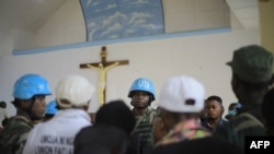 Malawian peacekeepers of the United Nations Organization Stabilization Mission in the Democratic Republic of the Congo (MONUSCO) stand inside the Emmanuel Butsili Catholic Church in Beni, June 27, 2021, after a makeshift bomb exploded.