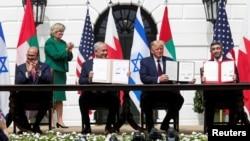 Bahrain's FM Abdullatif al-Zayani, Israel's PM Benjamin Netanyahu, US President Donald Trump and United Arab Emirates (UAE) FM Abdullah bin Zayed participate in the signing of the Abraham Accords, at the White House, Sept. 15, 2020.