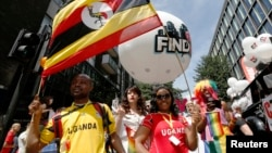Participants from Uganda, where homosexuality is outlawed, participate in the annual Pride London parade which highlights issues of the gay, lesbian and transgender community, London, June 29, 2013.