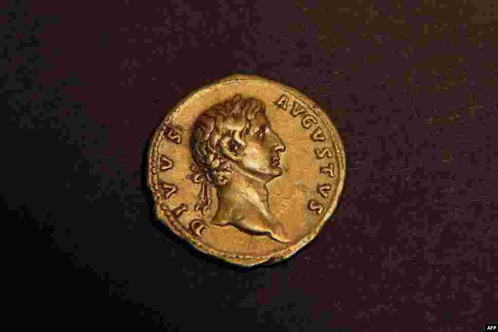 A 24 karat gold coin that was minted in Rome in 107 CE and bears the portrait of the emperor Augustus, after it was found by an Israeli hiker the previous week in the eastern Galilee before being handed to the Israeli authorities in Jerusalem.