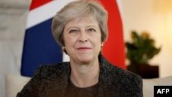 Theresa May lors d'une réunion à 10 Downing Street à Londres, le 24 juillet 2018.