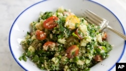 A dish of tabbouleh filled with herbs and spices. (AP Photo/Matthew Mead)