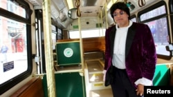 Cloyd Thomas, a Cleveland regional Transit Authority Trolley driver poses as Prince inside his trolley as part of the Rock and Roll Hall of Fame Induction week in Cleveland, Ohio, April 15, 2015.