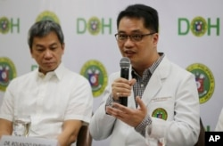 Department of Health Undersecretary Dr. Rolando Enrique Domingo, right, and Philippine General Hospital Director Dr. Gerardo Legaspi, attend a press conference at the Department of Health office in Manila, Philippines, Feb. 2, 2018.
