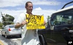 Cet Américain non identifié dit avoir perdu son emploi alors qu'il a deux enfants à nourrir (Archives)