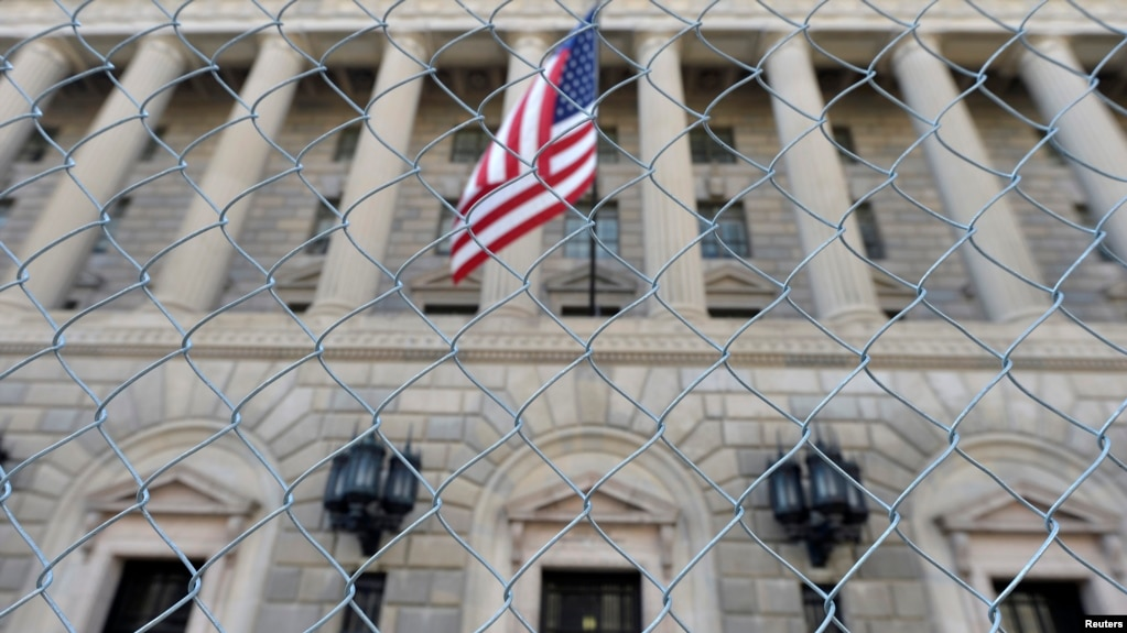 file a fence surrounds the u s department of commerce in washington oct 5