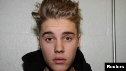 Canadian pop singer Justin Bieber is pictured in police custody in Miami Beach, Florida January 23, 2014 in this Miami Beach Police Department handout released to Reuters on March 4, 2014.